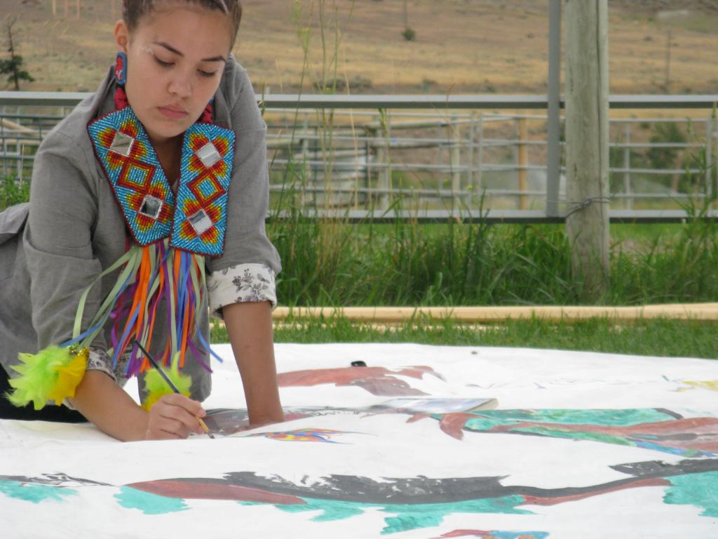 beautifully adorned native woman painting